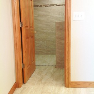 A seamless tile floor, with heating elements for those Wintery days, is an All About Bathrooms speciality. Colorado Bathroom Remodeling.