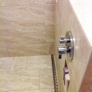 Soap storage built into this bathroom remodel by All About Bathrooms located in Aurora, CO